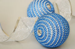 Blue Ð¡hristmas balls and decoration ribbon Royalty Free Stock Photos