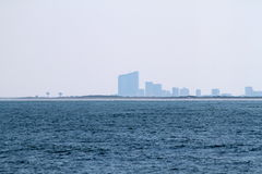 All Blue. Blue hazy City on  edge of Blue Ocean Royalty Free Stock Images