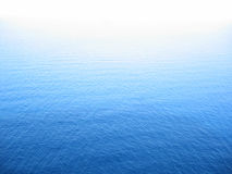 Blue. Water infinity ocean cyan peace deep calm white shading Royalty Free Stock Photography