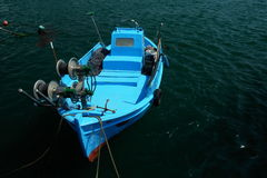 Blue. Fishing boat at Mixaniona marina royalty free stock photos