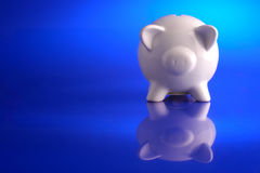 In the blue. Piggy bank saving Stock Images