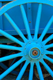 Blue. Wooden wagon wheel Stock Photos