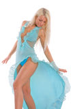 Blue. The beautiful blonde in a blue dress in movement Royalty Free Stock Photos