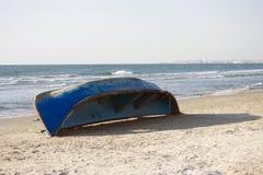 Blue abandoned boat Royalty Free Stock Image