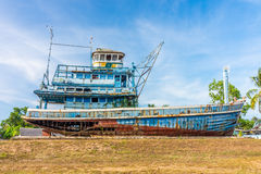 Blue abandoned fishing boat ruin in Phang Nga, Thailand Royalty Free Stock Photo
