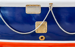 Blue aboard an old ship and hanging on the rope it in bronze eyelets Royalty Free Stock Image