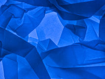 Blue abstract background. Backlit tissue paper. Textured irregular patterned background. Unusual stock image