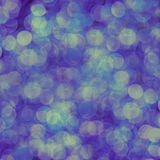 Blue abstract background of blurred lights with bokeh effect stock photography
