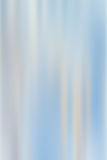 Blue abstract background with blurred vertical light strips. Pastel abstract background with gray and white vertical stripes on blurred blue background Royalty Free Stock Photography