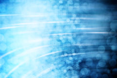 Blue Abstract Background. Abstract blue background with gradation, bokeh, and  a curving motion Stock Images