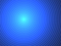 Blue abstract background rings. An abstract cold blue background with a pattern of concentric rings (waves) with a kind of flash in the central point. Can be Stock Image
