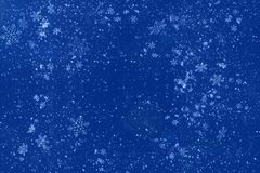 Blue abstract background with white snowflakes. Copy space. New year and Christmas celebration concept. New year 2020 royalty free stock images