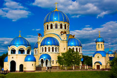 Blue abstract church on field. Blue abstract church in Moscow, Russia and bright sky Stock Image