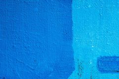 Blue abstract hand painted canvas background, texture. Colorful textured backdrop royalty free stock images