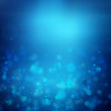 Blue abstract light background. Blue abstract lights bokeh background Royalty Free Stock Photography