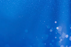 Blue abstract light bokeh background Stock Images