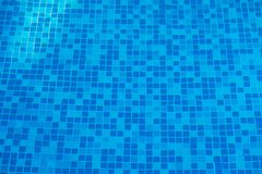 Blue abstract mosaic tiles at the bottom of the swimming pool, b Stock Images