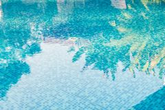 Blue abstract mosaic tiles at the bottom of the swimming pool, b Stock Photo
