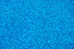 Blue abstract mosaic tiles at the bottom of the swimming pool, b Stock Photography