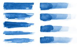 Watercolor. Blue abstract painted ink strokes set on watercolor paper. Ink strokes. Flat kind brush stroke. stock photo