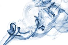 Blue abstract smoke from the aromatic sticks on a white background. Royalty Free Stock Images
