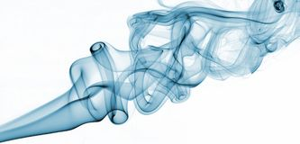 Blue abstract smoke from the aromatic sticks on a white background. Stock Photography
