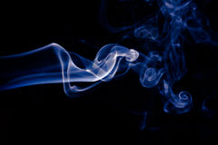 Blue abstract smoke design on black background.  Stock Photography