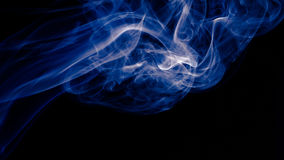 Blue abstract smoke design on black background Stock Photo