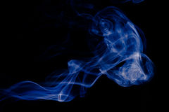 Blue abstract smoke design on black background Stock Photography