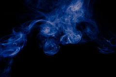 Blue abstract smoke design on black background.  Royalty Free Stock Images