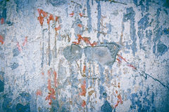 Blue abstract texture of concrete wall with splashes of red paint. Сracked stone surface. Vintage style Stock Photos