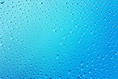 Blue Abstract Water Drops  Background. With Beautiful Light and Shadows -  focus on the center, horizontal Stock Photos