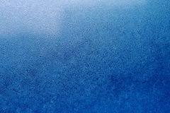 Blue abstract water drops background. Abstract water drops background in deep navy blue color macro Stock Images