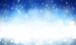 Blue abstract winter background. With snow and snowflackes Stock Image
