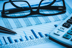 Blue Accounting financial spreadsheet data with glasses pen and calculator Stock Photography