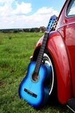 Blue acoustic guitar Stock Photo