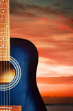 Blue Acoustic Guitar. Blue classic acoustic guitar, on nature background Royalty Free Stock Photo