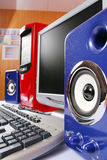 Blue acoustic systems with red computer. Blue acoustic systems, red computer with keyboard and display in the office Stock Photos