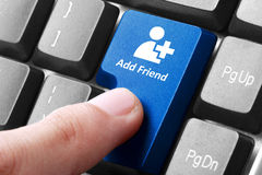 Blue add friend button on the keyboard. Closeup of blue add friend button on the keyboard Stock Photography
