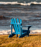Blue adirondack chair Stock Image