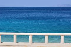 Blue adriatic sea with banister. Podgora, Croatia Royalty Free Stock Photo
