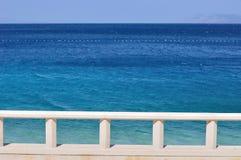 Blue adriatic sea with banister. Podgora, Croatia royalty free stock photo