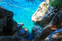 Ð•he blue Adriatic Sea and white rocks are saturated stock image