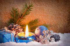 Blue advent candle and snow. Royalty Free Stock Image