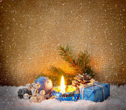 Blue advent candle and snow. Royalty Free Stock Photo