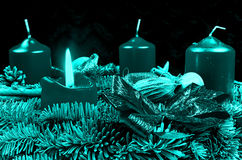 Blue Advent wreath with burning candle Stock Images