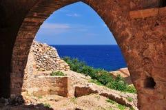 The blue Aegean sea. Through an arch in Monemvasia Greece Stock Image