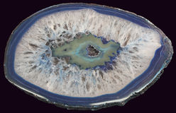 Blue Agate. Cross section of blue agate isolated on black background Stock Photos