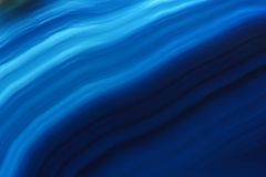 Blue agate gem background (macro, detail) Royalty Free Stock Photo