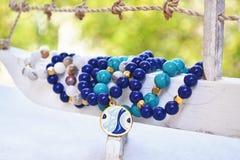 Blue agate gemstone bracelets - greek jewelry with evil eye Stock Photos
